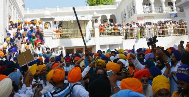 SGPC Task force volunteers and radical Sikh activists clash in the Golden Temple complex on the 30th anniversary of the army's Operation Bluestar in Amritsar on June 6, 2014. (Photo: IANS)