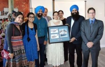 Displaying the recently-unveiled Canada Post stamp to commemorate 100th anniversary of Komagata Maru incident, State Minister (Multiculturalism) and Brampton West MP Kyle Seeback are in a group photo with family members of Baba Gurdit Singh — one of the key figures who actually chartered the Komagata Maru ship — and board members of Sikh Heritage Museum of Canada after making the funding announcement for the museum to create a unique exhibit called Lions of the Sea.