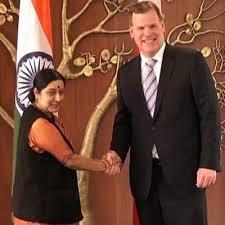 Sushma Savraj and John Baird