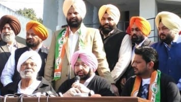 Singer-actor Balkar Sidhu (seated, right) with Punjab Congress chief Capt Amarinder Singh (centre) after joining the party in Chandigarh on Tuesday (Ravi Kumar/HT Photo)