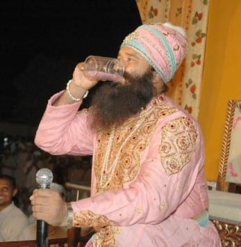 "Ram Rahim making his ""Amrit""."