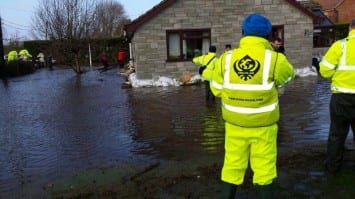 Khalsa Aid volunteers and the local community continue to work against time to protect homes in the floods affected areas of BurrowBridge, Somerset, UK.